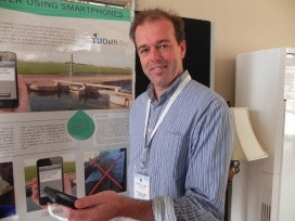 Peter-Jules van Overloop displaying his mobile phone app for canal management