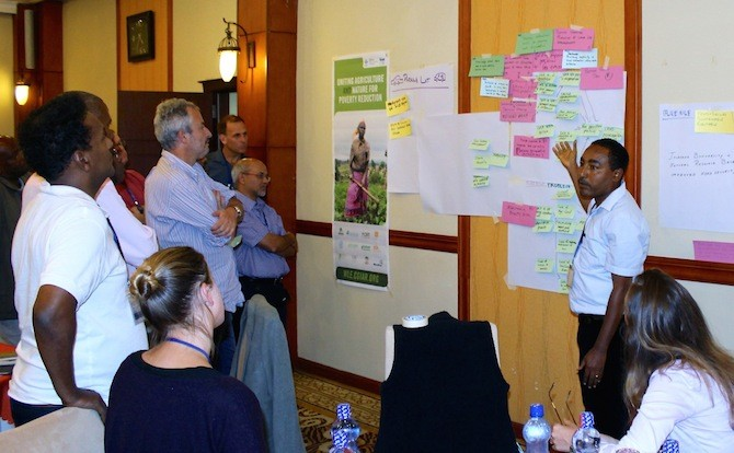 Writeshop participants work in groups based on sub-regions. The Blue Nile Group maps