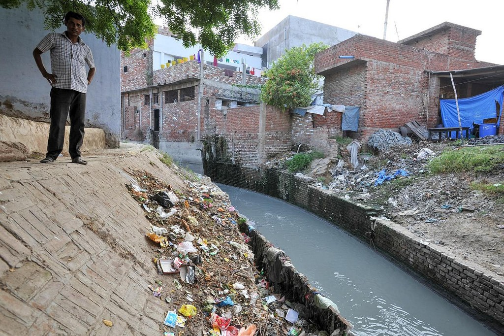 Polluted water flows towards the Ganges river, near Kanpurm India.