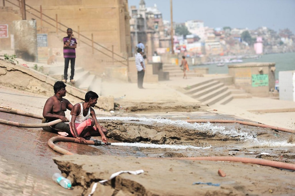 cleaning the ganga ghat steps