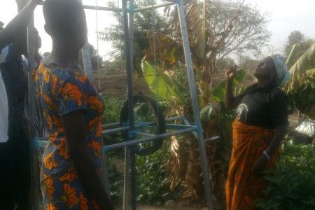 A farmer using a rope and washer pump for irrigation in Nyangua, Upper East Region, Ghana.