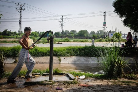 Pumping water from a tube well, Pakistan