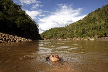 A 16-year-old Karen boy swims in the Salween River at the Myanmar-Thai border.
