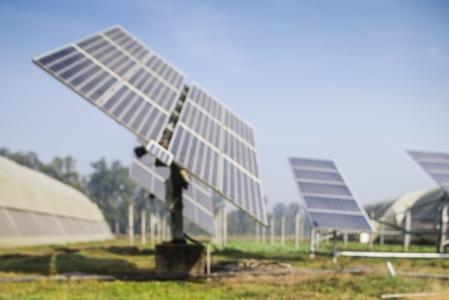 A farm with a solar water pump.