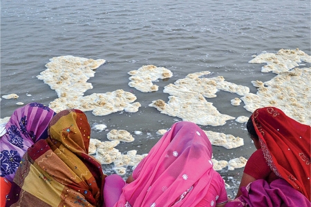 Women worship on polluted bank of the Ganges, in Allahabad, India.
