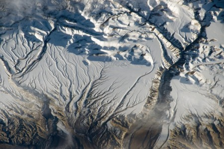 For millions of years, rivers and streams in the Himalaya range near the China–India border has eroded rock from the high mountains and deposited sediment in ancient, broad alluvial fans.