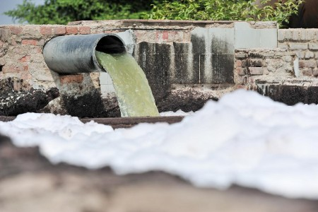 Wastewater is pumped into channels for irrigation, in Kanpur, India.