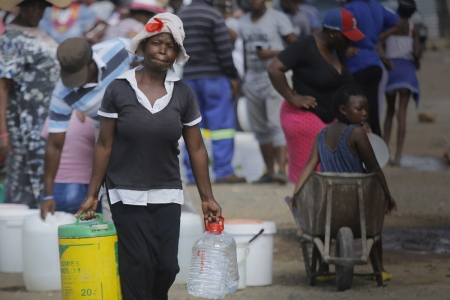Residents queue for water at a distribution point in the farming town of Senekal in the Free State.