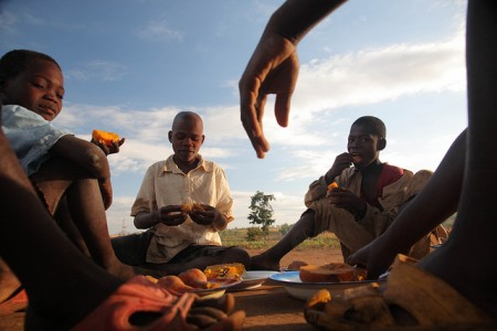 Mozambique eating sweet potato