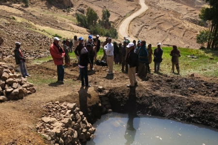 A presentation made at the workshop shows the stark difference in landscapes in Ethiopia – (L) without interventions and (R) with sustainable intensification.
